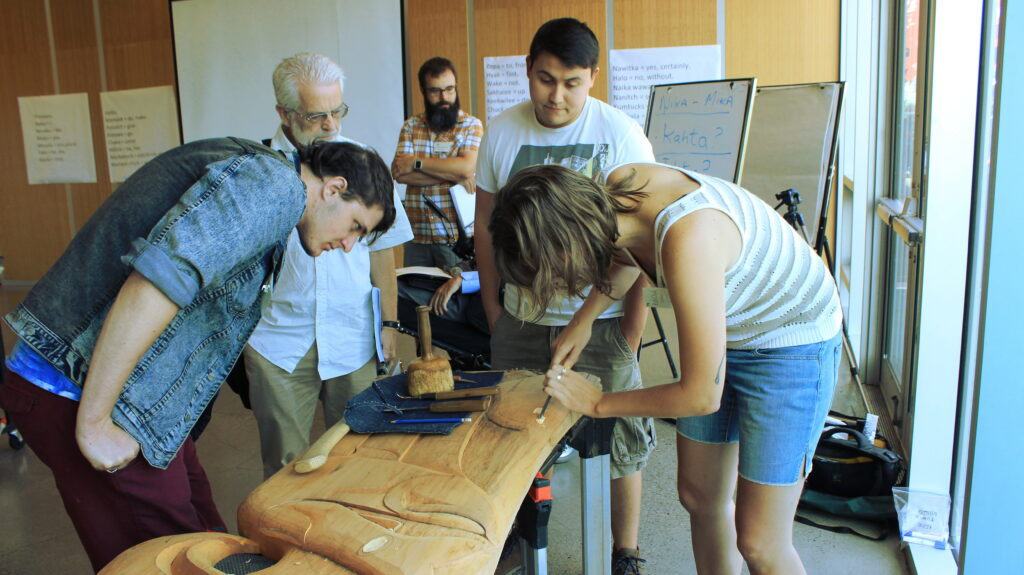 Students try their hand at wood carving.